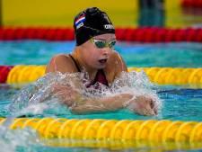 Schouten zwemt in Nederlands record op 100 meter schoolslag naar Spelen