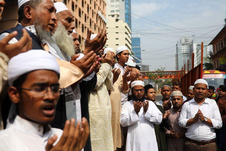Moslims over de hele wereld bidden voor de slachtoffers van de aanslagen in Christchurch.  Beeld REUTERS
