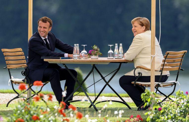 Twee maanden geleden presenteerde Merkel samen met de Franse president Emmanuel Macron een Europees herstelfonds van 500 miljard euro. Beeld Photo News