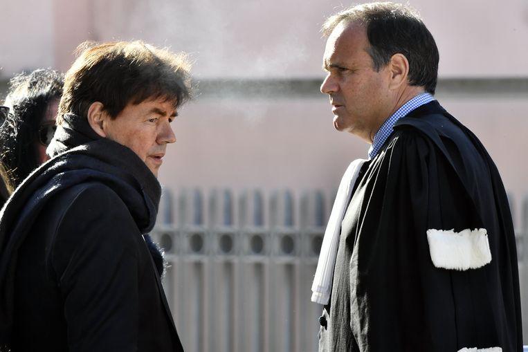 Wesphael overlegt met zijn advocaat Jean-Philippe Mayence. Beeld BELGA