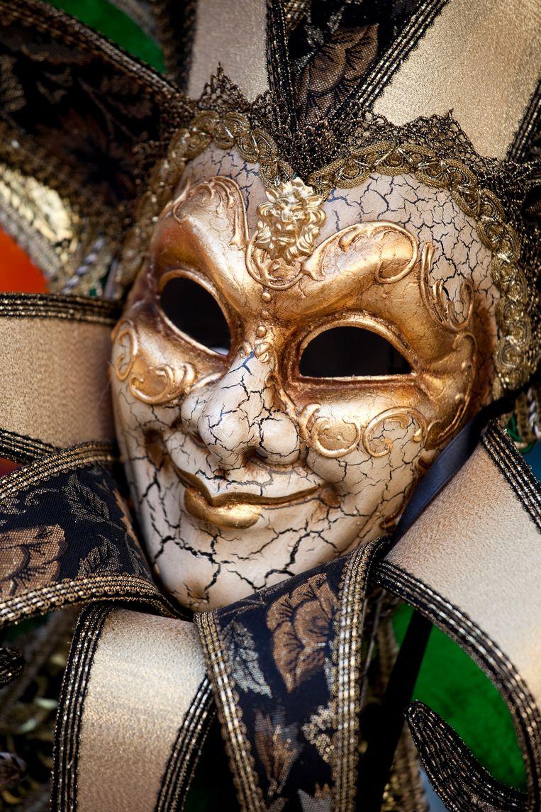Een Venetiaans masker dat gedragen wordt tijdens de Italiaanse carnavalsviering Mardi Gras. Beeld Getty Images/iStockphoto