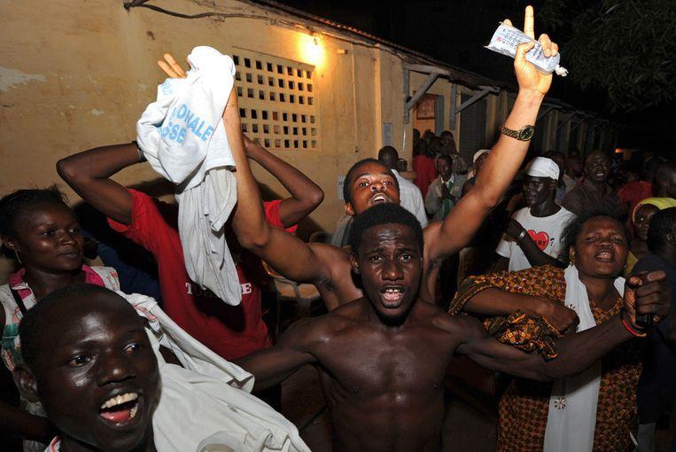 Archieffoto uit 2010. In Guinee vieren aanhangers van Alpha Conde diens overwinning in de eerste vrije presidentsverkiezingen. Beeld afp
