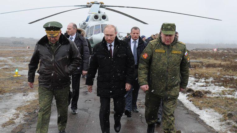 De Russische president Poetin, kort na de Russische bezetting van de Krim. Beeld BELGA