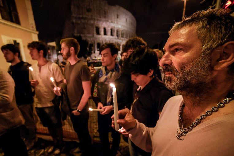 Bij het Colosseum in Rome worden stiltemomenten gehouden. Beeld AFP