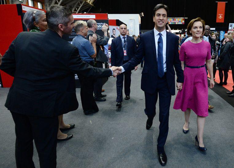 Ed Miliband, leider van de Britse Labour Party, met zijn vrouw nadat hij een speech heeft gegeven tijdens het partijcongres in Manchester, september 2014. Beeld Stefan Rousseau/Getty