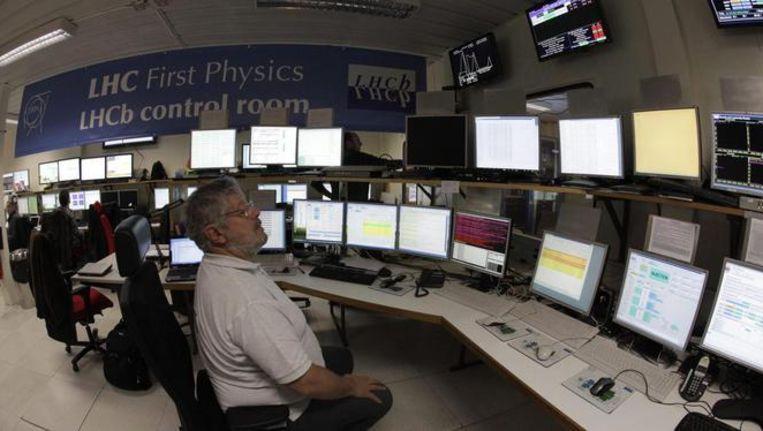 Onderzoekers van het LHCb-experiment op deeltjeslab CERN. Beeld anp