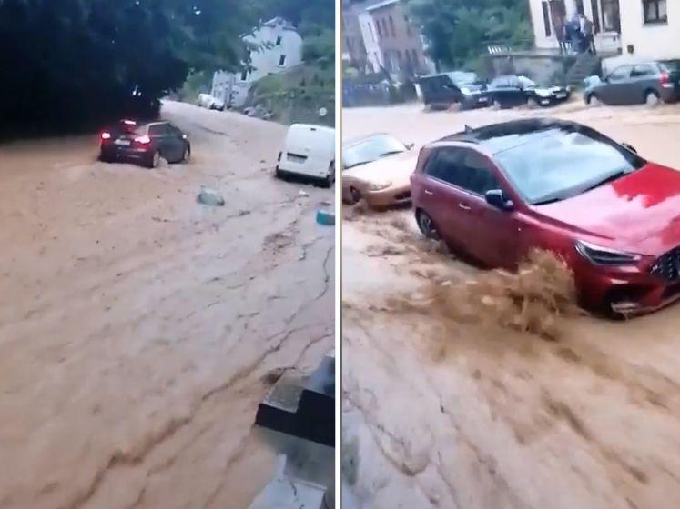 Straat verandert in luttele seconden in kolkende rivier