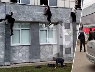 Minstens zes doden nadat jonge schutter Russische universiteit binnenvalt: beelden tonen hoe studenten uit raam springen om te ontsnappen