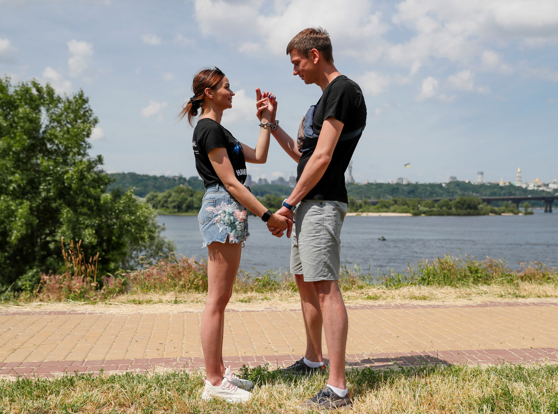 Alexandr Kudlay en Viktoria Pustovitova Beeld REUTERS