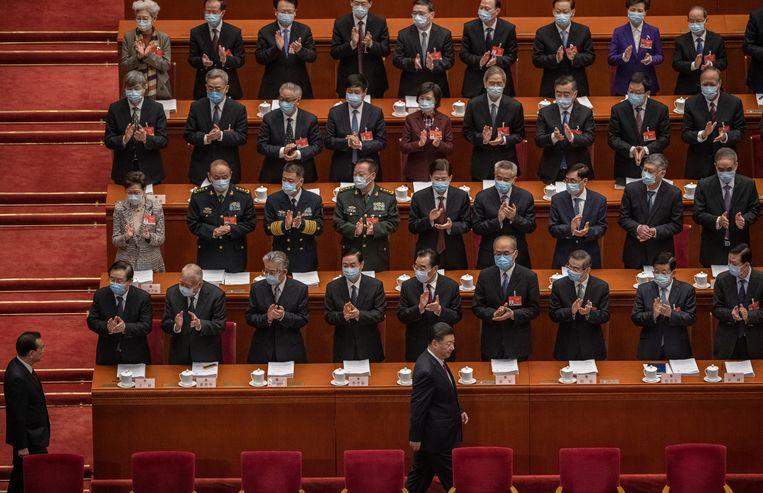 President Xi Jinping en premier Li Keqiang op de eerste dag van het Nationaal Volkscongres. Beeld Getty Images