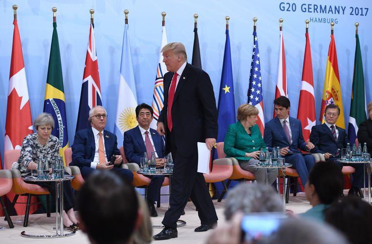 President Trump net voor hij op de G20-top in Hamburg in een toespraak betoogde tegen acties voor het klimaat. Beeld AFP