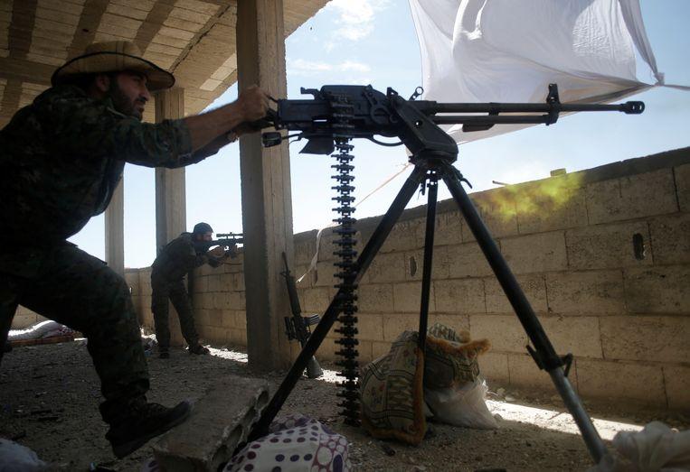 Archiefbeeld van de YPG-militie die strijd voert tegen IS in Raqqa. Beeld REUTERS