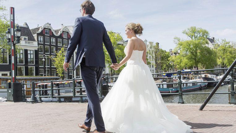 In Amsterdam werden vorig jaar 2170 betaalde huwelijken gesloten. Beeld anp