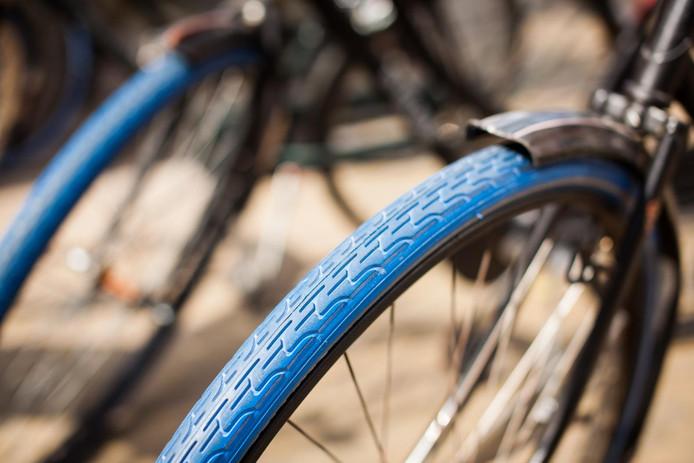 Je herkent een fiets van Swapfiets aan de typische blauwe voorband.