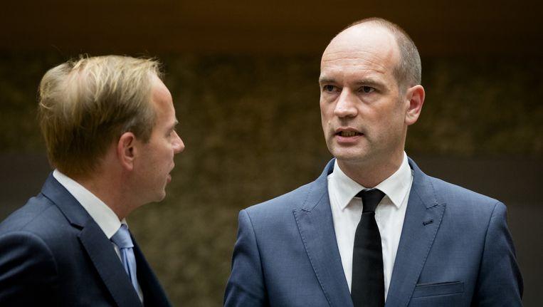 Kees van der Staaij (SGP) en Gert-Jan Segers (ChristenUnie) tijdens de regeling van werkzaamheden. Beeld anp