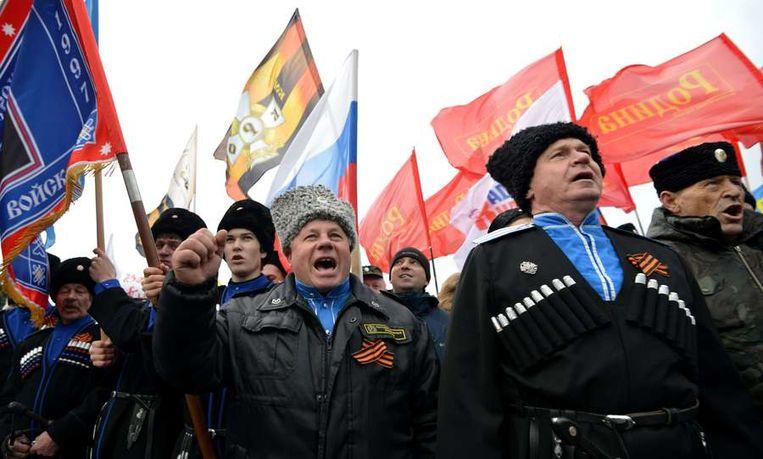 Kozakken in het zuiden van Rusland vieren de annexatie van de Krim. Beeld afp