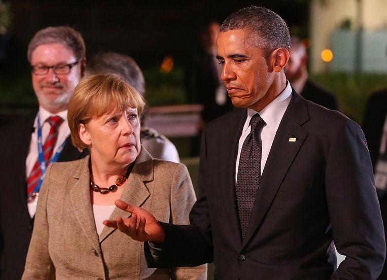 Angela Merkel sprak zich tijdens de G-20 top uit over de sancties tegen Rusland. Beeld AFP PHOTO / POOL / Chris Hyde