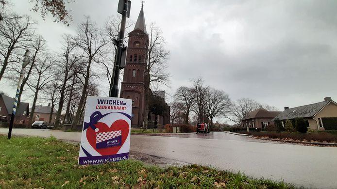 Een reclamebord voor de Wijchense cadeaukaart in Hernen.