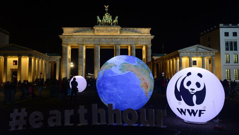 28 maart: Earth Hour bij de Brandenburger Tor in Berlijn. Beeld AFP