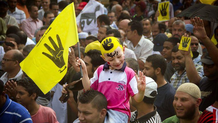 Supporters van Morsi tijdens een demonstratie eind 2013. Beeld ap