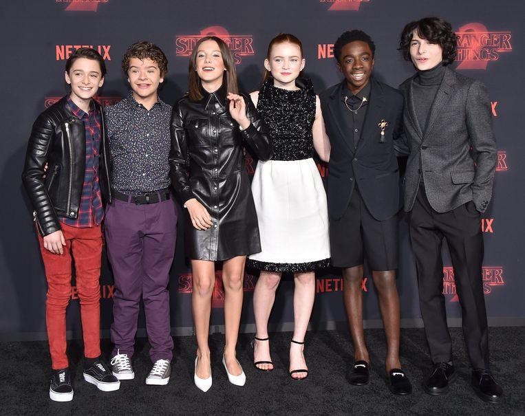 De cast van Stranger Things, die centraal staat in de eerste aflevering van De Netflix NL Podcast Beeld Photo News