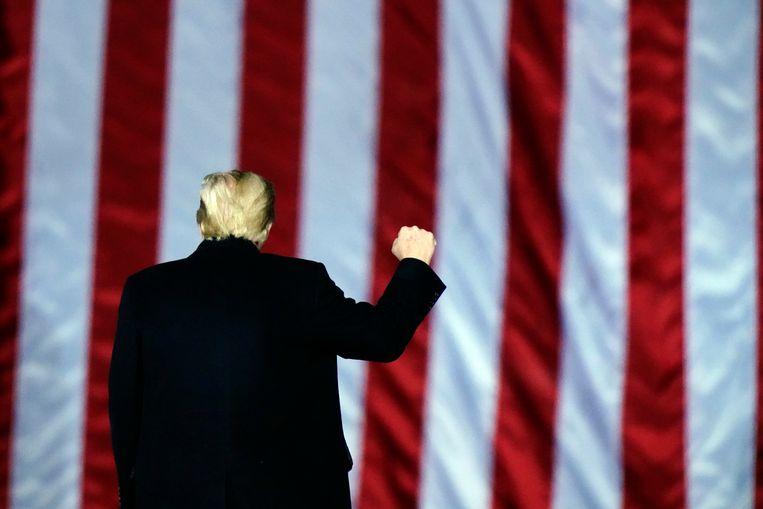 De Amerikaanse president Donald Trump tijdens een campagnebijeenkomst in Georgia eerder deze week. Twitter heeft het account van Trump permanent geblokkeerd. Beeld AP