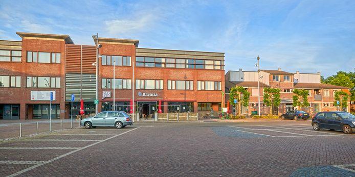 Links het gebouw van De Pas, rechts het gebouw van de bibliotheek aan de Misse in Heesch.