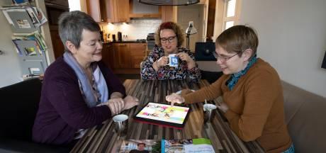 'Coronaboek' brengt 13.000 euro op: Watersteeg in Veghel dankt er een mooie tuin met bankjes aan