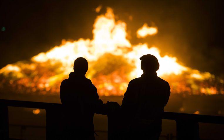 Het Scheveningse vreugdevuur tijdens de nieuwsjaarsnacht. Beeld ANP