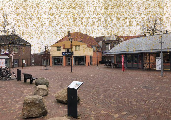 Het Zwaaiplein waar op 12 maart  met blauwe steentjes in het wegdek de 60 jaar eerder opgeheven gemeentegrens werd aangebracht.