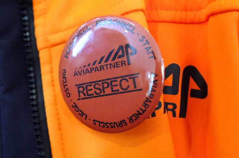 'Respect', roept deze badge.  Beeld BELGA