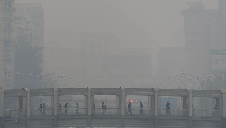 De hoeveelheid smog in Chinese steden is enorm. Beeld AFP