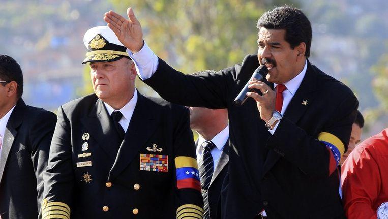 Rechts de interim-president en favoriet voor de opvolging van Chávez, Maduro Beeld ANP
