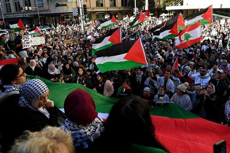 Betogers bij het stadhuis van Sydney. Beeld AFP