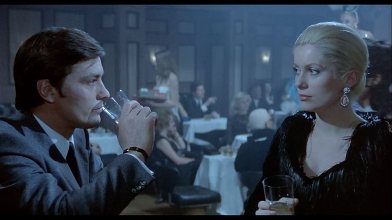 Alain Delon en Catherine Deneuve in Un flic van Jean-Pierre Melville Beeld