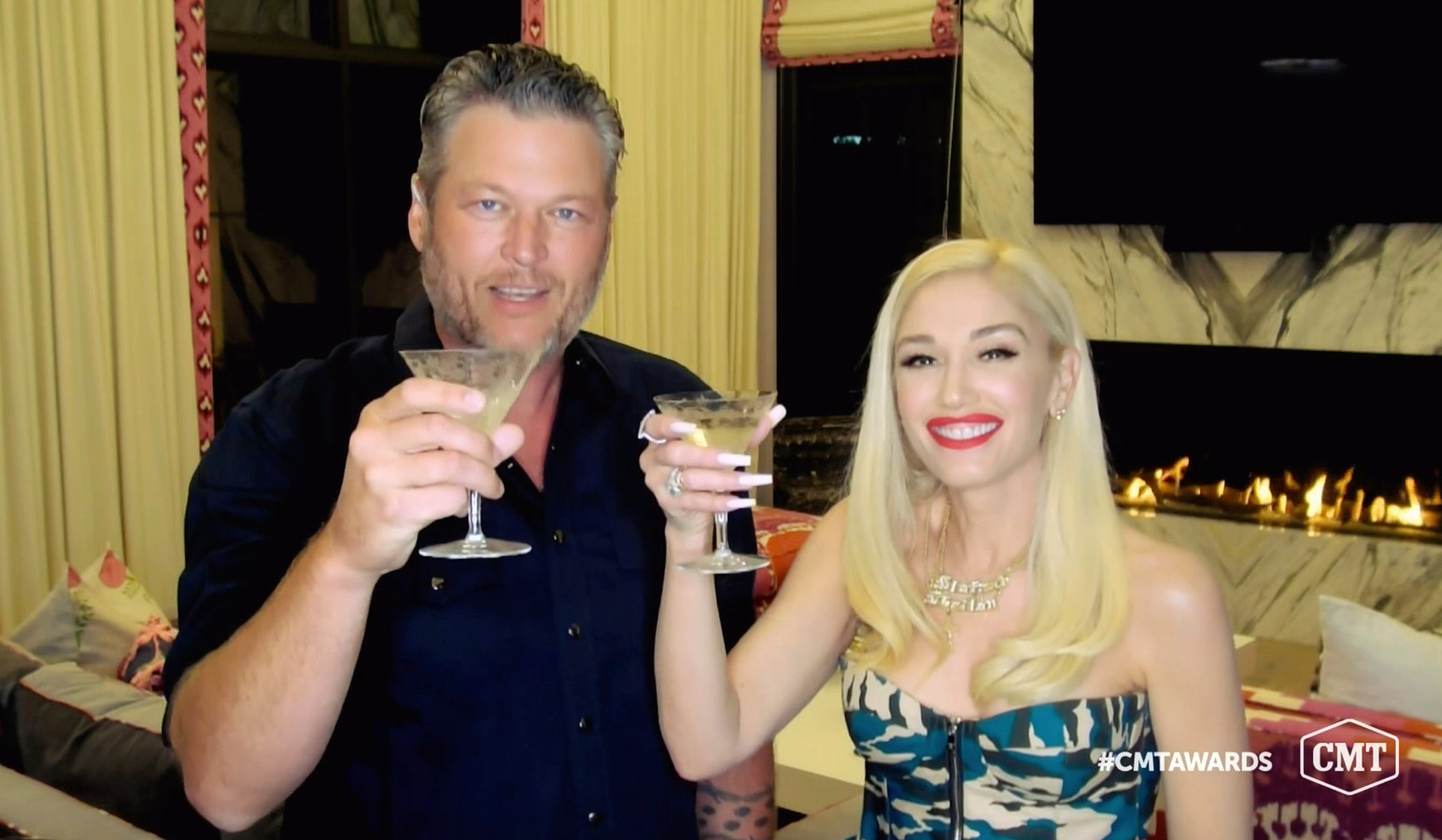 In this video image provided by CMT, Blake Shelton, left, and Gwen Stefani  toast as they accept the collaboration of the year award for âĜNobody But Youâĝ during the Country Music Television awards airing on Wednesday, Oct. 21, 2020. (CMT via AP)