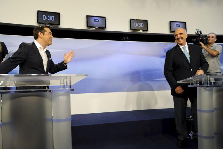 Alexis Tsipras en Evangelos Meimarakis tijdens een tv-debat vorige week. Beeld REUTERS