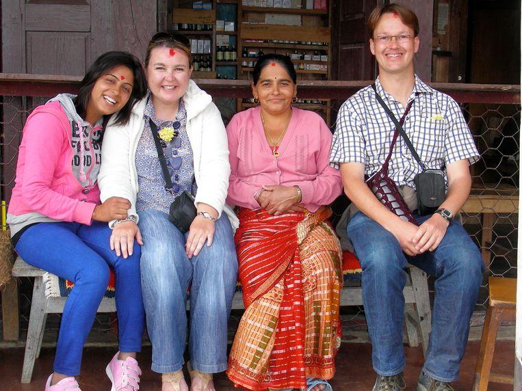 Met onze Nepalese vrienden voor hun apotheek. Beeld Maarten Rabaey