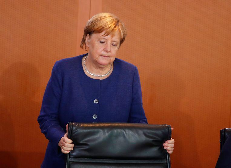 Bondskanselier Angela Merkel begint aan het wekelijkse kabinetsoverleg in Berlijn, 26 september.  Beeld Reuters