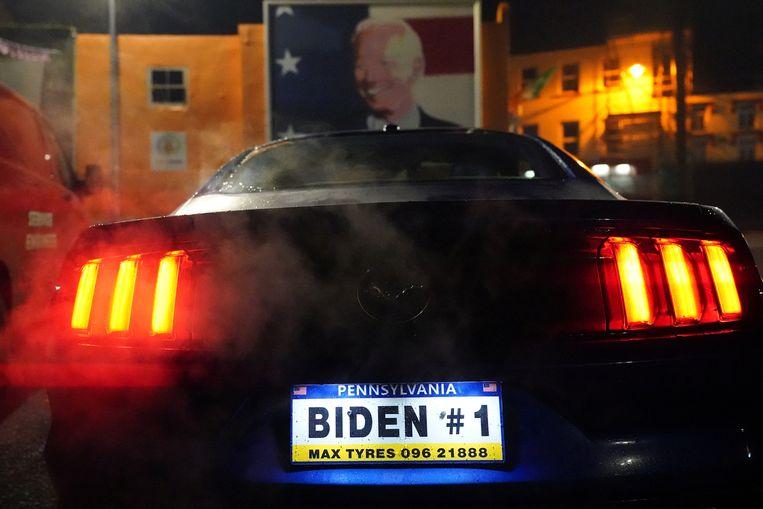 Een Ford Mustang met een gepersonaliseerde nummerplaat. Beeld Reuters