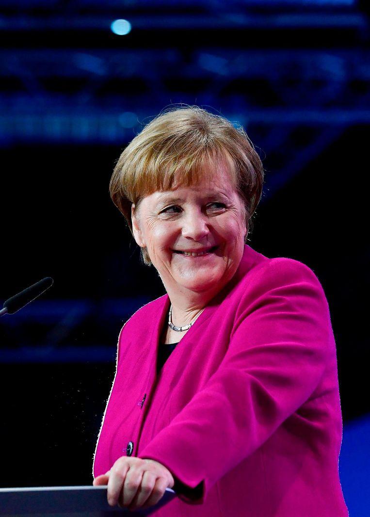 Angela Merkel presenteerde maandag op het CDU partijcongres al haar nieuwe ministers. Beeld afp