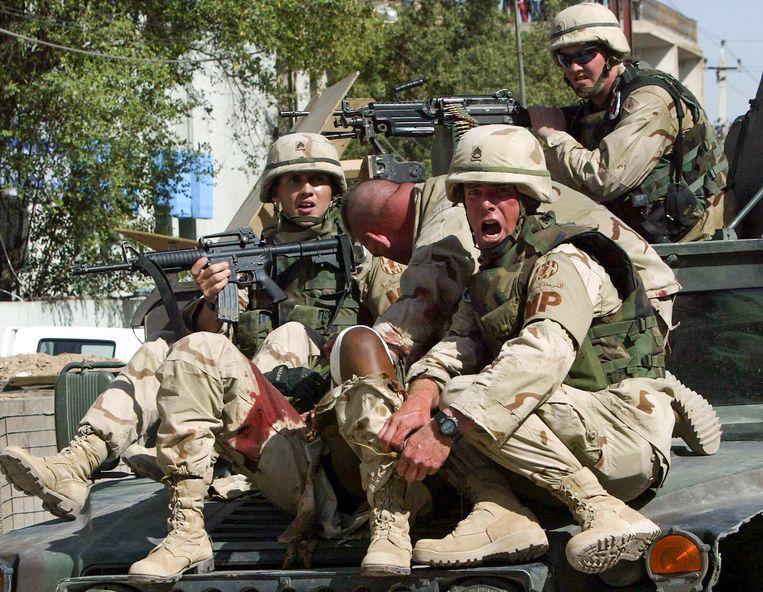 Amerikaanse soldaten in mei 2004 in Irak.  Beeld EPA