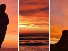 Nagenieten van kleurrijke zonsondergang en dubbele regenboog