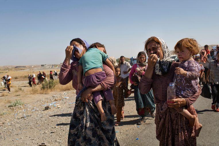 Jezidi's die tijdens de genocide hun thuis in Sinjar, Irak, waren ontvlucht, komen terug uit Syrië. Beeld NYT