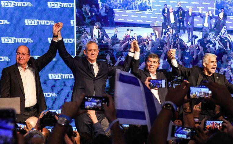 Benny Gantz (tweede van links) eiste de overwinning op. Beeld AFP