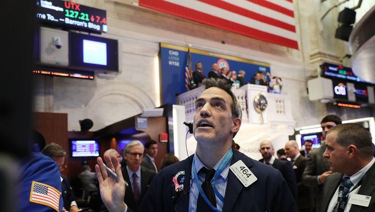 Een handelaar maandag op Wall Street. Beeld afp