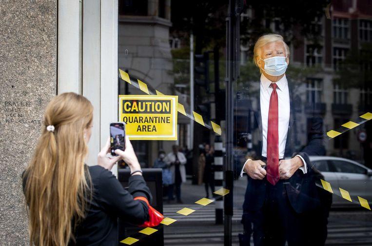 Het wassen beeld van Donald Trump bij Madame Tussauds in oktober 2020 'in quarantaine' geplaatst. Beeld ANP