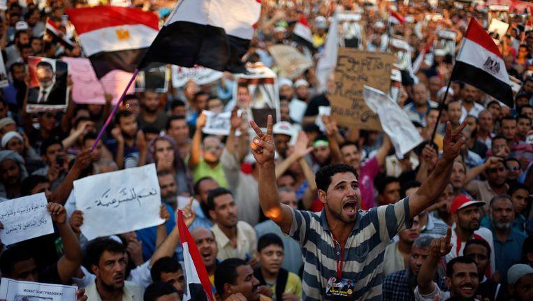Supporters van de Egyptische president Mohamed Morsi. Beeld REUTERS