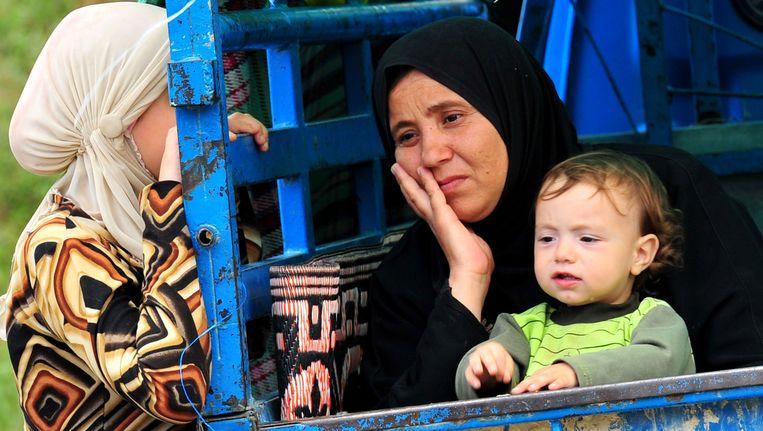 Meer dan tienduizend vluchtelingen verlieten Syrië als het gevolg van de strijd tussen het leger en anti-regeringsdemonstranten. Beeld AFP