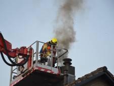 Forse rookschade aan woning na schoorsteenbrand